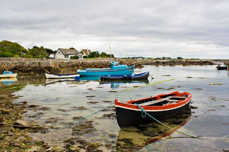 Several boats tied up on the edge of Galway Bay, Ireland.