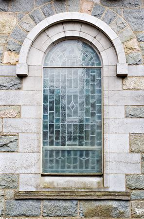 An old church window showing much detail and texture Stock Photo - 1747847