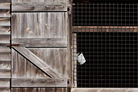 pales: An old barn with a hanging bucket in Allaire Village, New Jersey. Allaire village was a bog iron industry town in New Jersey during the early 19th century. Stock Photo