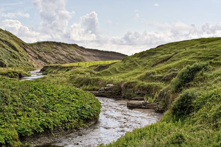 A stream in rolling hills of Ireland