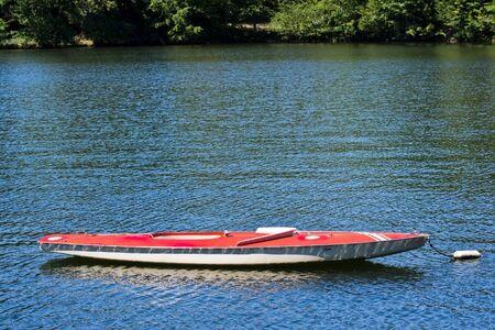 sunfish: A docked sunfish boat on a lake Stock Photo