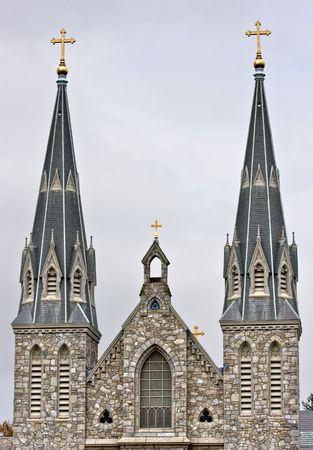 steeples: An old brick church with large steeples