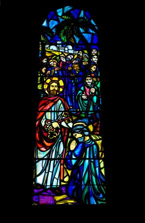 stained glass windows: A religious stained glass window inside a church Stock Photo