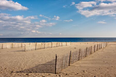 Wooden fences on the beach, The fences are on the sand in the foreground with the ocean and sky above. Stock Photo - 3994158