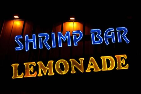 Shrimp Bar and Lemonade neon sign in front of a restaurant Stock Photo - 5240460