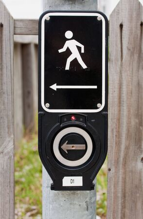 A modern walk signal at a street intersection photo