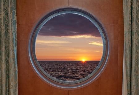 View of a sunrise through a cruise ship window