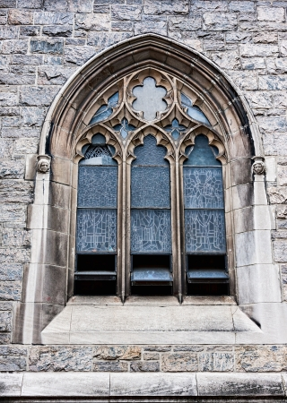 window: An old church window showing much detail and texture Stock Photo