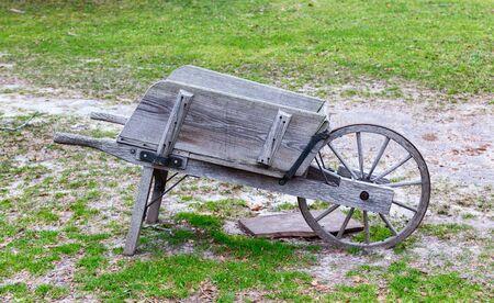 wheelbarrow: An old wooden wheelbarrow