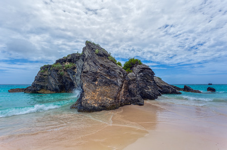 A large rock in the atlantic ocean in the coastal waters of Bermuda.