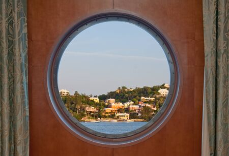 Bermuda coastline seen through a cruise ship porthole