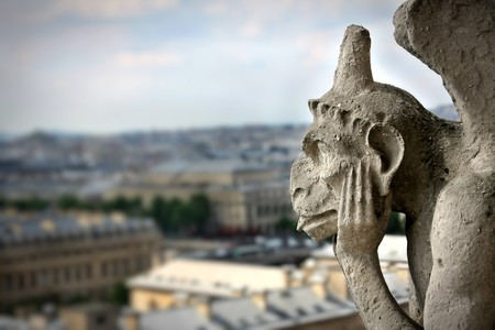 gargoyle: Gargoyle on Notre Dame Cathedral Stock Photo