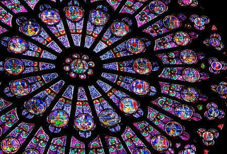 church window: Stained-glass window of Notre Dame de Paris Editorial