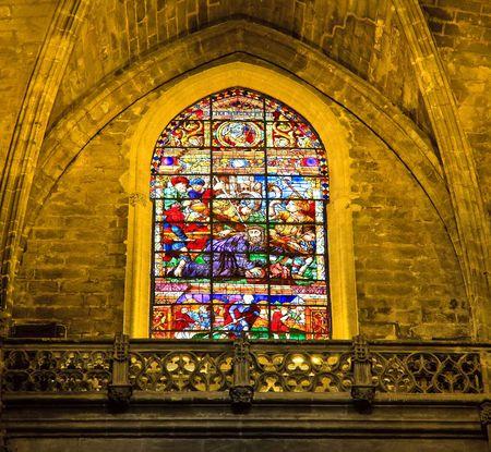 Stained-glass window in La Giralda, Seville, Spain photo