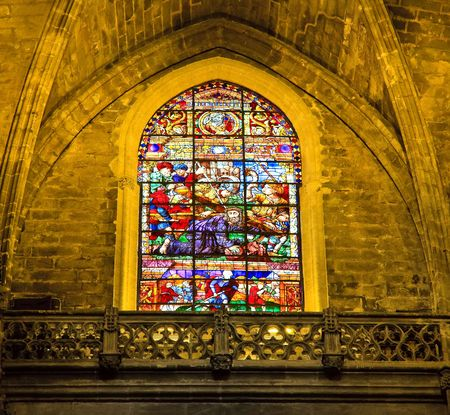 seville: Stained-glass window in La Giralda, Seville, Spain