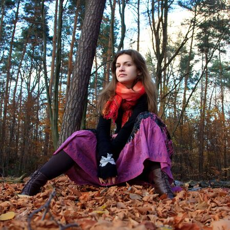 Portrait of young woman in autumn park photo