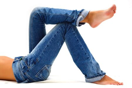 Girl's legs in a blue jeans Stock Photo - 5338877