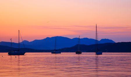 poros: Yachts at sunset, Aegean sea, Greece Stock Photo