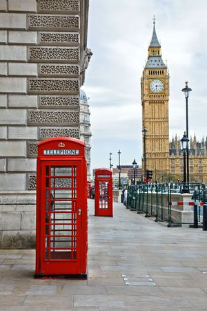 Big Ben and phone booths in London photo