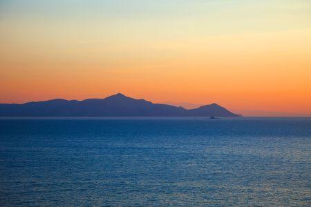 Islands in Aegean sea before sunrise, Greece photo