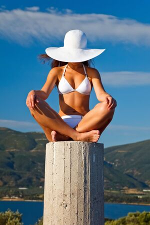 Young woman in white bikini Stock Photo - 6370849