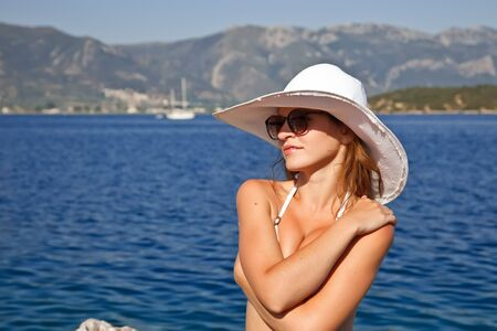 Young woman in white hat photo