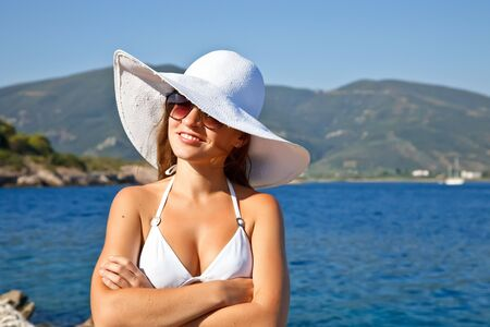 Young woman in white hat Stock Photo - 6410952