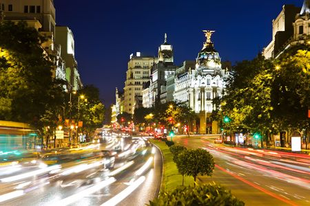 Street traffic in night Madrid, Spain photo