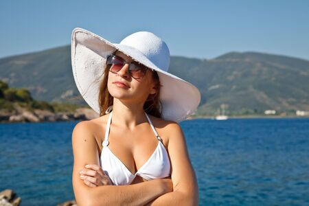 Outdoor portrait of young woman in white hat Stock Photo - 6662168