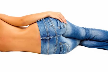 Back of topless girl in blue jeans photo