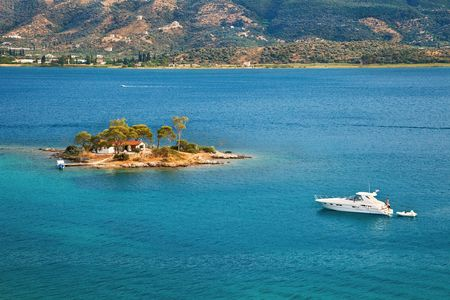 Small island in Aegean sea, Greece Stock Photo - 6818479