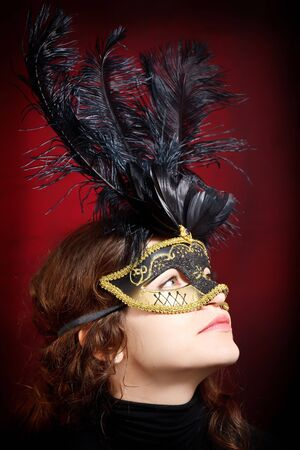 Young woman in carnival mask photo