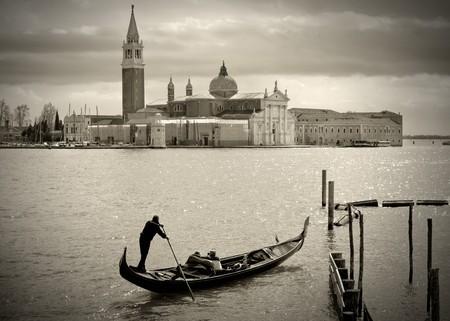 Gondolier in front of San Giorgio Maggiore, Venice photo