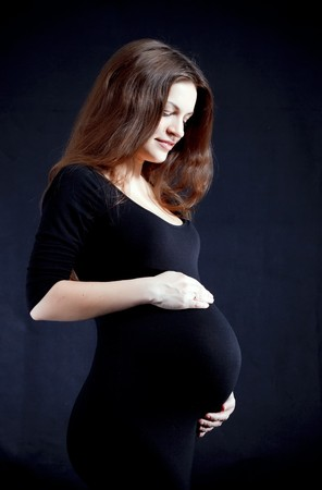 Beautiful pregnant woman in black Stock Photo - 7347567
