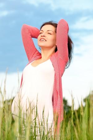 Beautiful pregnant woman on meadow Stock Photo - 7347582