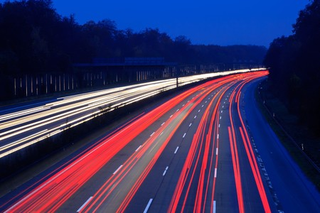 light traces: Night time traffic on highway Stock Photo