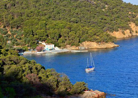 poros: Yacht in small bay, Poros, Greece Stock Photo