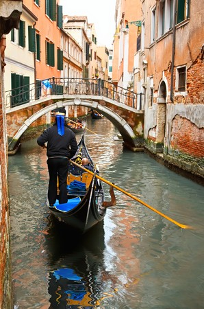 Gondolas on canal in Venice photo