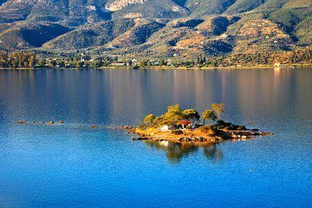 peloponnesus: Small island in Aegean sea, Greece Stock Photo