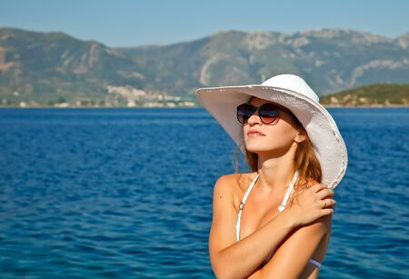 Outdoor portrait of young woman in white hat Stock Photo - 7553066