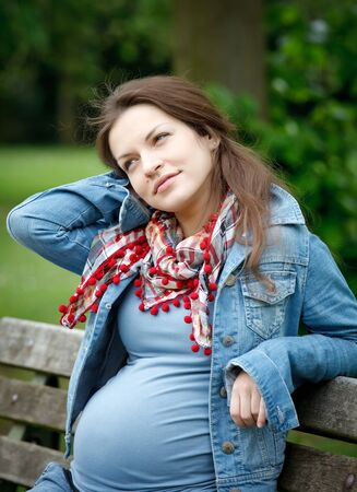 Beautiful pregnant woman in the park Stock Photo - 7553078