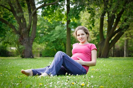 Beautiful pregnant woman relaxing in the park Stock Photo - 7553097