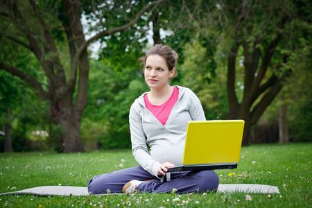 Beautiful pregnant woman in the park Stock Photo - 7553093
