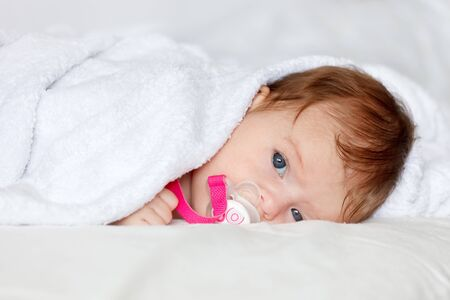 nipple girl: Portrait of resting baby Stock Photo