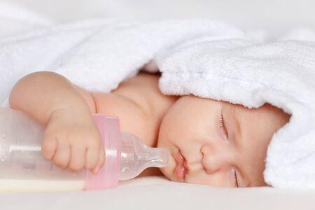 baby bottle: Sleeping baby girl