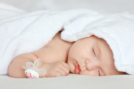 white blanket: Sleeping baby girl