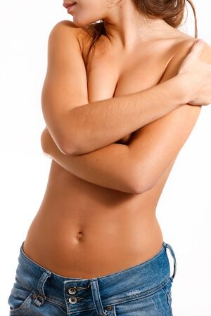 hot girl nude: Torso of a girl in blue jeans Stock Photo