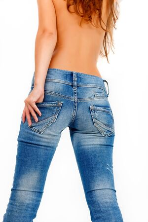 Back of a girl in blue jeans photo
