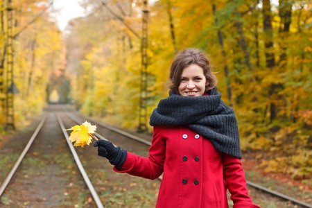 Young happy woman in autumn park Stock Photo - 7893622