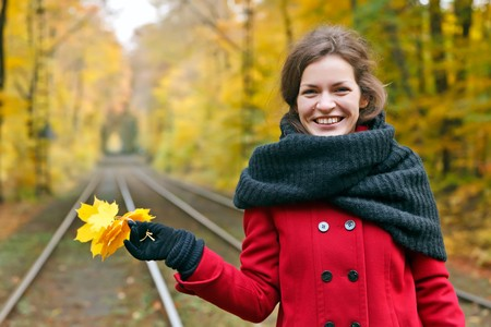 Young happy woman in autumn park Stock Photo - 7893631